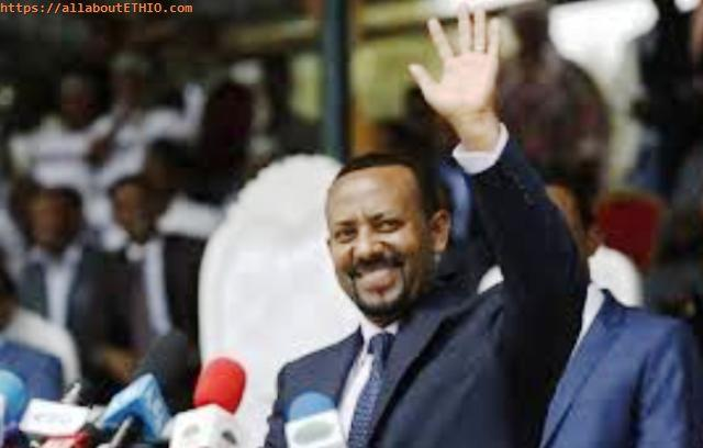 abiy ahmed waving to crowd