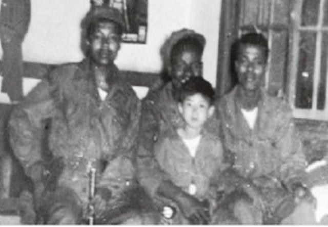ethiopia korean war kagnew battalion with korean child